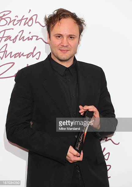 Nicholas Kirkwood poses in the awards room at the British Fashion Awards 2012 at The Savoy Hotel on November 27 2012 in London England