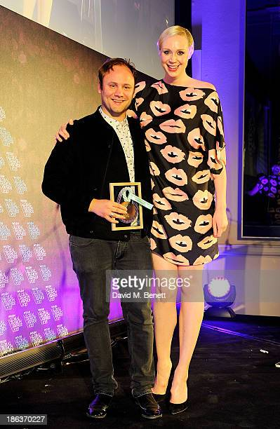 Nicholas Kirkwood winner of Accessories Footwear Designer and Gwendoline Christie pose onstage at The WGSN Global Fashion Awards at the Victoria...