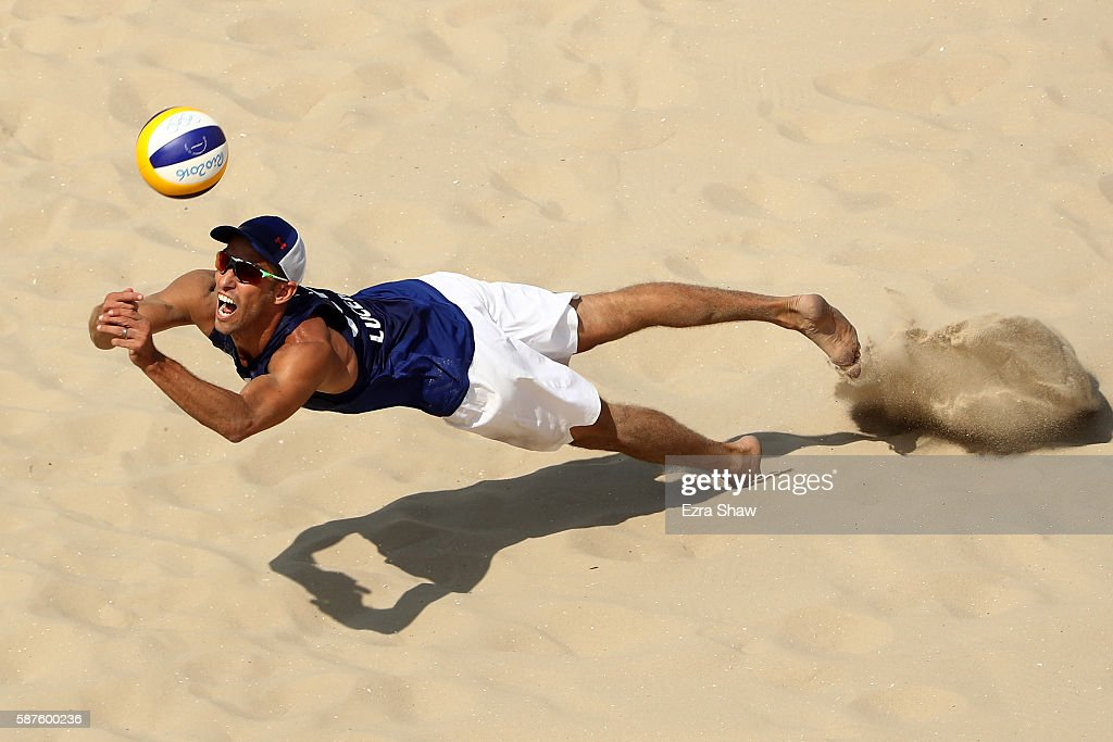 Nicholas Lucena of United States bumbs the ball during the Men's Beach Volleyball Preliminary Pool C match against Rodolfo Lombardo Ontiveros Gomez...