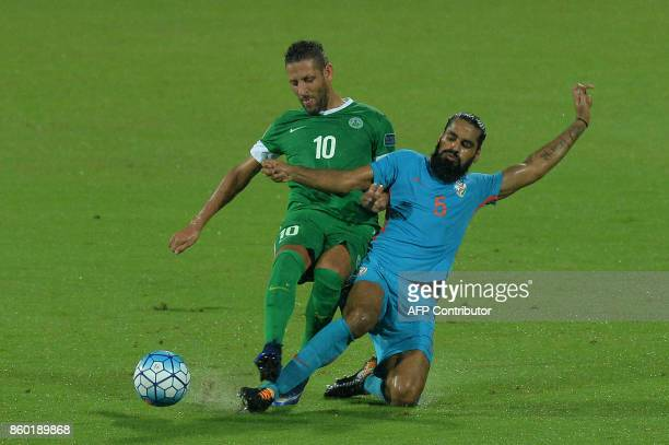 Nicholas Mario Tarrao of Macau and Sandesh of India chase the ball during the 2019 AFCAsian Cup qualifying match between India and Macau held at the...