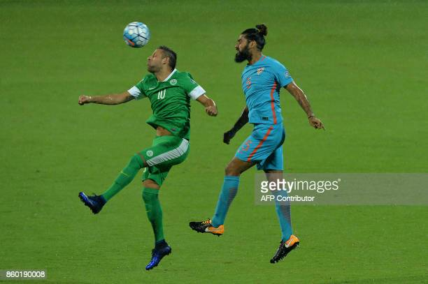 Nicholas Mario Tarrao of Macau and Sandesh of India head the ball during the 2019 AFCAsian Cup qualifying match between India and Macau held at the...