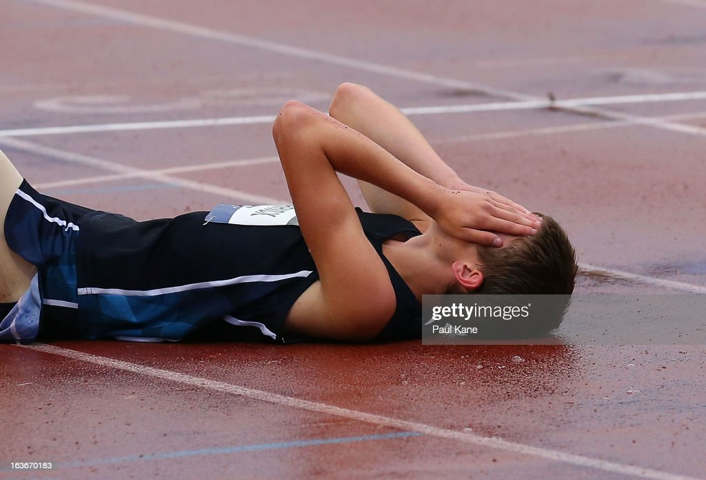 Nicholas Merrick of Victoria reacts after sustaining an injury in the men's u18 400 metre hurdles final during day three of the Australian Junior Championships at the WA Athletics Stadium on March 14, 2013 in Perth, Australia.
