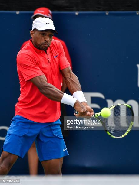 Nicholas Monroe of the United States hits a return shot against Karen Khachanov of Russia and Dominic Thiem of Austria during day four of the Rogers...