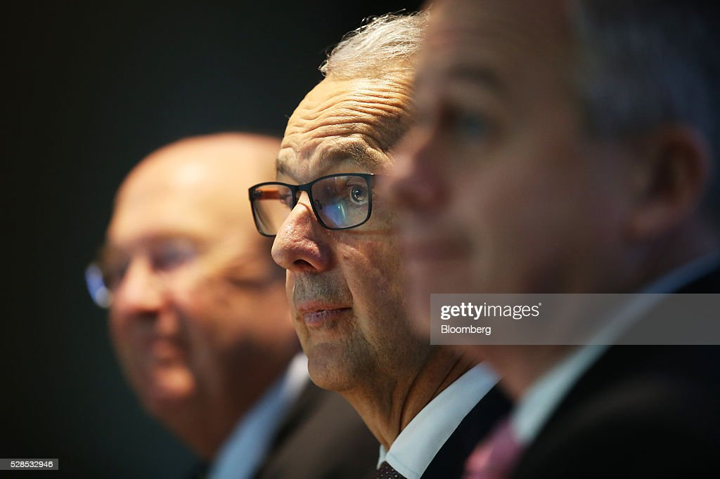 Nicholas Moore, chief executive officer and managing director of Macquarie Group Ltd., center, listens during a news conference in Sydney, Australia, on Friday, May 6, 2016. Macquarie said full-year profit climbed 29 percent to a record as it flagged lower performance fees from its funds-management unit and signaled that subdued markets may weigh on current-year earnings. Photographer: Brendon Thorne/Bloomberg via Getty Images