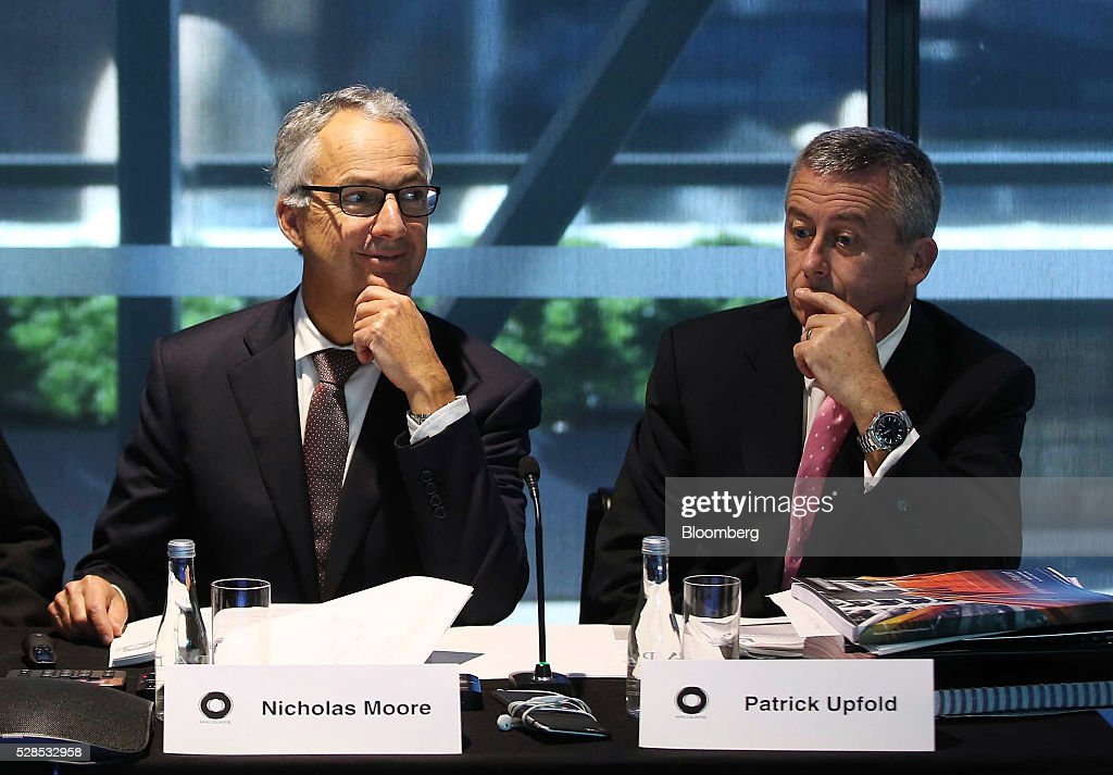 Nicholas Moore, chief executive officer and managing director of Macquarie Group Ltd., left, and Patrick Upfold, chief financial officer, attend a news conference in Sydney, Australia, on Friday, May 6, 2016. Macquarie said full-year profit climbed 29 percent to a record as it flagged lower performance fees from its funds-management unit and signaled that subdued markets may weigh on current-year earnings. Photographer: Brendon Thorne/Bloomberg via Getty Images