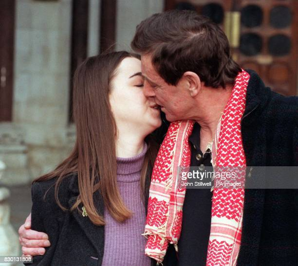 Nicholas Mullen the last Republican prisoner being held in a British jail kisses his daughter Jessica as he leaves the Court of Appeal in London...