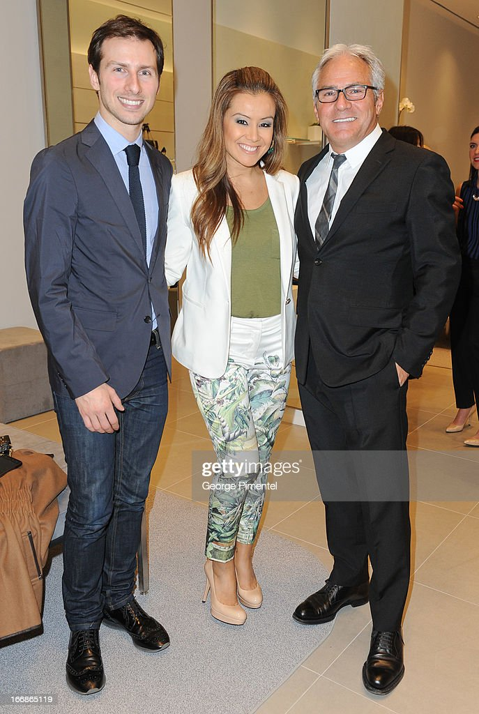 Nicholas Niro with Melissa Grelo and Franco Niro at the opening of the Stuart Weitzman Boutique on April 17, 2013 in Toronto Ontario Canada.