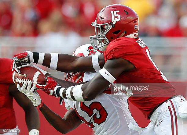 Nicholas Norris of the Western Kentucky Hilltoppers pulls in this reception against Ronnie Harrison of the Alabama Crimson Tide at BryantDenny...