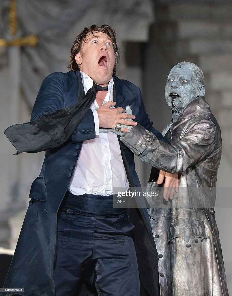 Nicholas Ofczarek (L) in the role of Jedermann and Ben Becker as Death perform during a rehearsal of 'Jedermann' (Everyman) on the Domplatz in Salzburg, Austria on July 19, 2012, ahead of the 2012 Salzburg Festival. A new chapter opens for The Salzburg Festival, the world-famous classical music, opera and drama extravaganza, when it kicks off on July 20 under homegrown new artistic director Alexander Pereira. The festival will run from July 20 till September 2, 2012.