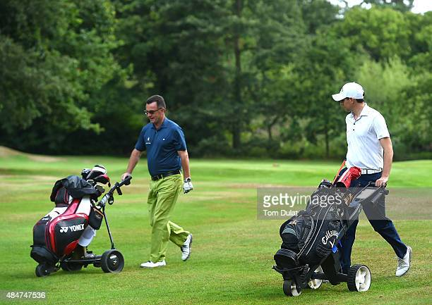 Nicholas Olson and Bill Sangster of Chart Hills Golf Club walk down the 1st fairway during the Golfplan Insurance PGA ProCaptain Challenge South...