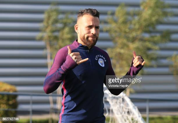 Nicholas Otamendi reacts during training at Manchester City Football Academy on October 18 2017 in Manchester England