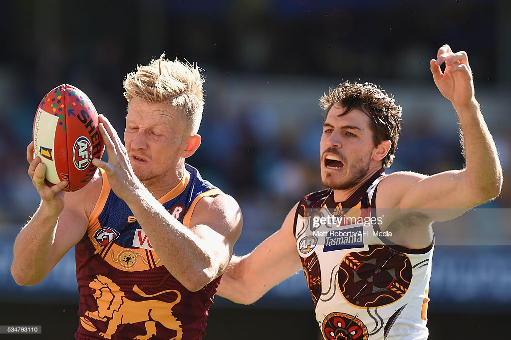 Nicholas Robertson of the Lions competes for the ball during the round 10 AFL match between the Brisbane Lions and the Hawthorn Hawks at The Gabba on May 28, 2016 in Brisbane, Australia.