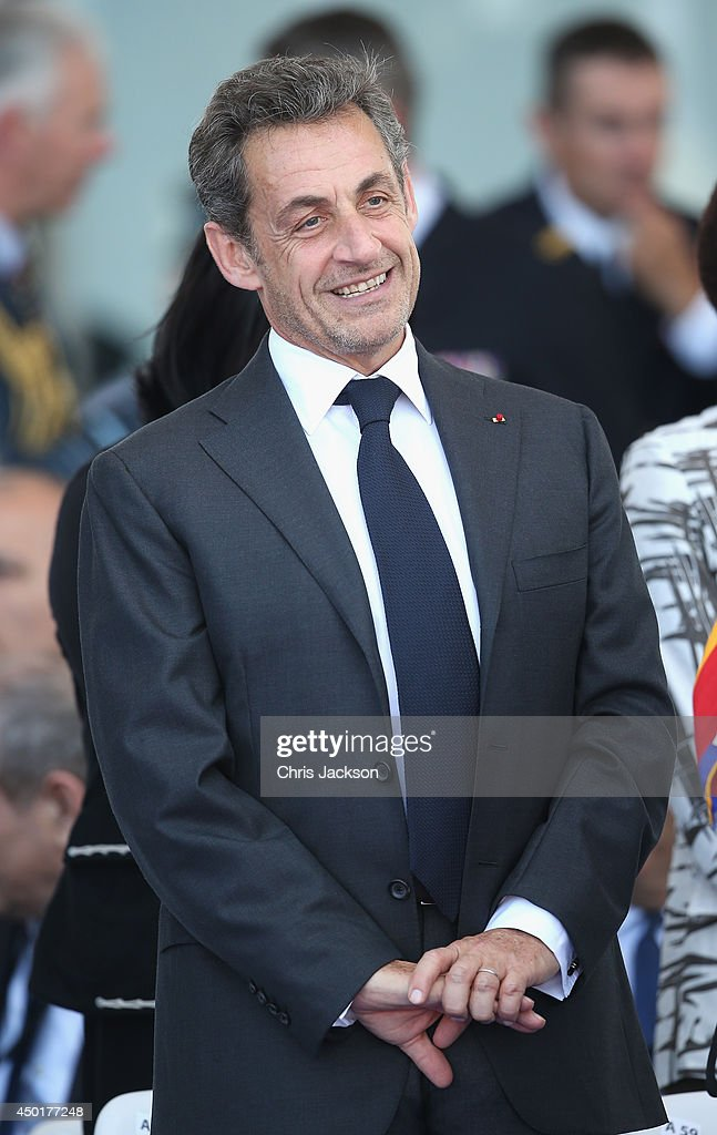 Nicholas Sarkozy at a Ceremony to Commemorate D-Day 70 on Sword Beach on June 6, 2014 in Ouistreham, France. Friday 6th June is the 70th anniversary of the D-Day landings which saw 156,000 troops from the allied countries including the United Kingdom and the United States join forces to launch an audacious attack on the beaches of Normandy, these assaults are credited with the eventual defeat of Nazi Germany. A series of events commemorating the 70th anniversary are planned for the week with many heads of state travelling to the famous beaches to pay their respects to those who lost their lives.