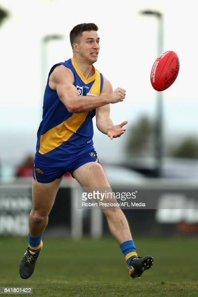 Nicholas Sing of Williamstown handballs during the VFL Qualifying Final match between Williamstown and Casey at Burbank Oval on September 2 2017 in...