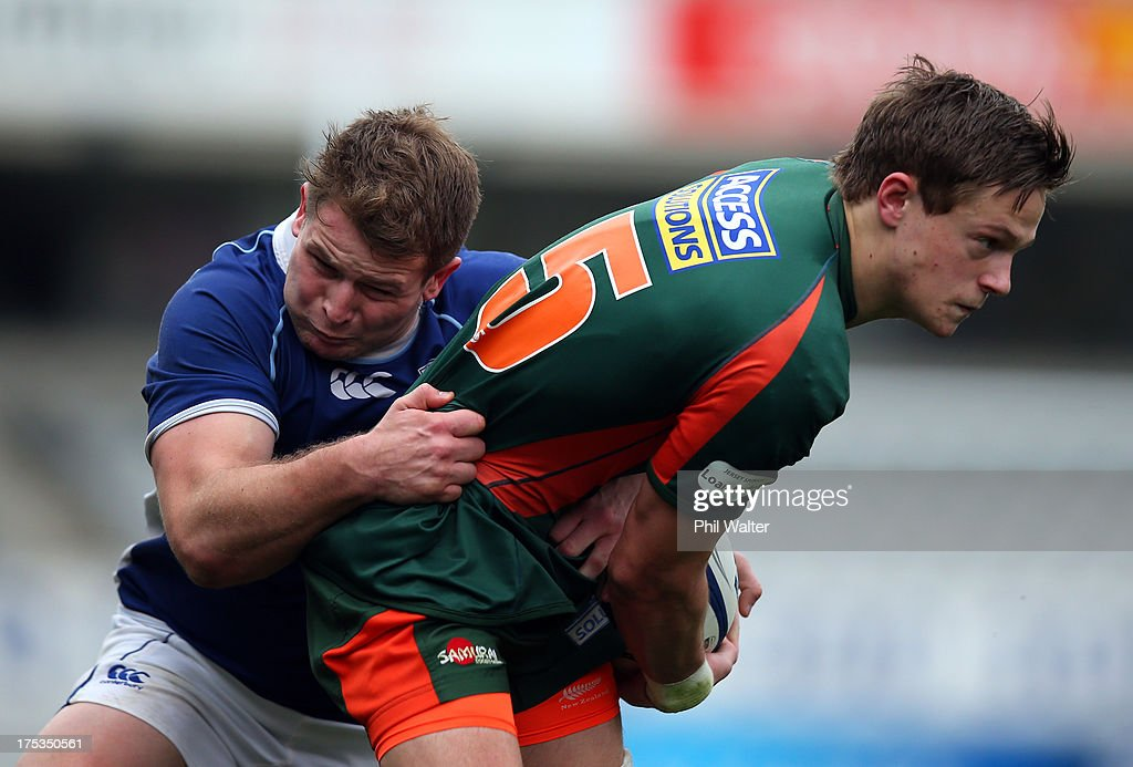 Nicholas Smith of Pakuranga is tackled by Brock Sibbick during the Gallaher Shield Final match between Pakuranga and University at Eden Park on August 3, 2013 in Auckland, New Zealand.