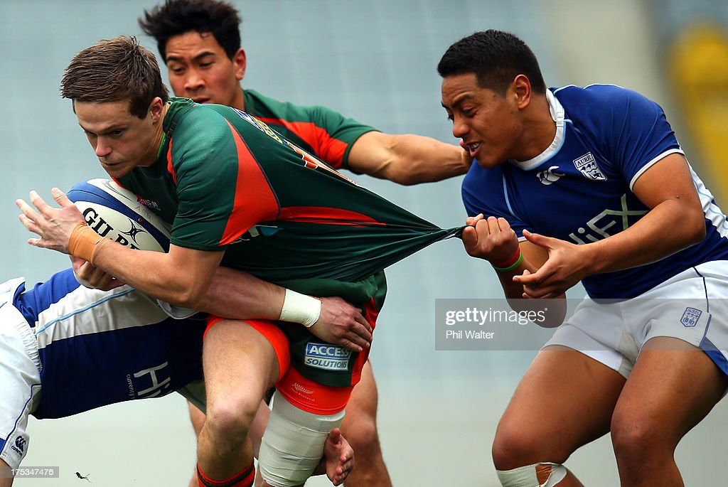 Nicholas Smith of Pakuranga is tackled by Kevin Fuavao of University during the Gallaher Shield Final match between Pakuranga and University at Eden Park on August 3, 2013 in Auckland, New Zealand.