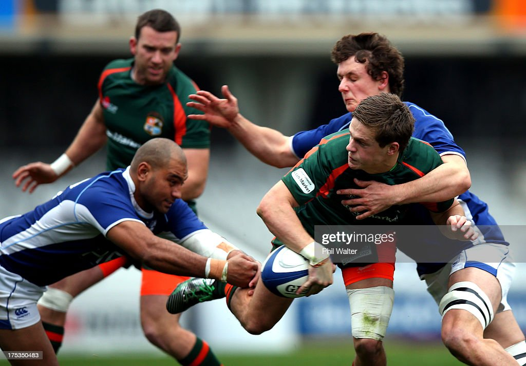Nicholas Smith of Pakuranga is tackled during the Gallaher Shield Final match between Pakuranga and University at Eden Park on August 3, 2013 in Auckland, New Zealand.