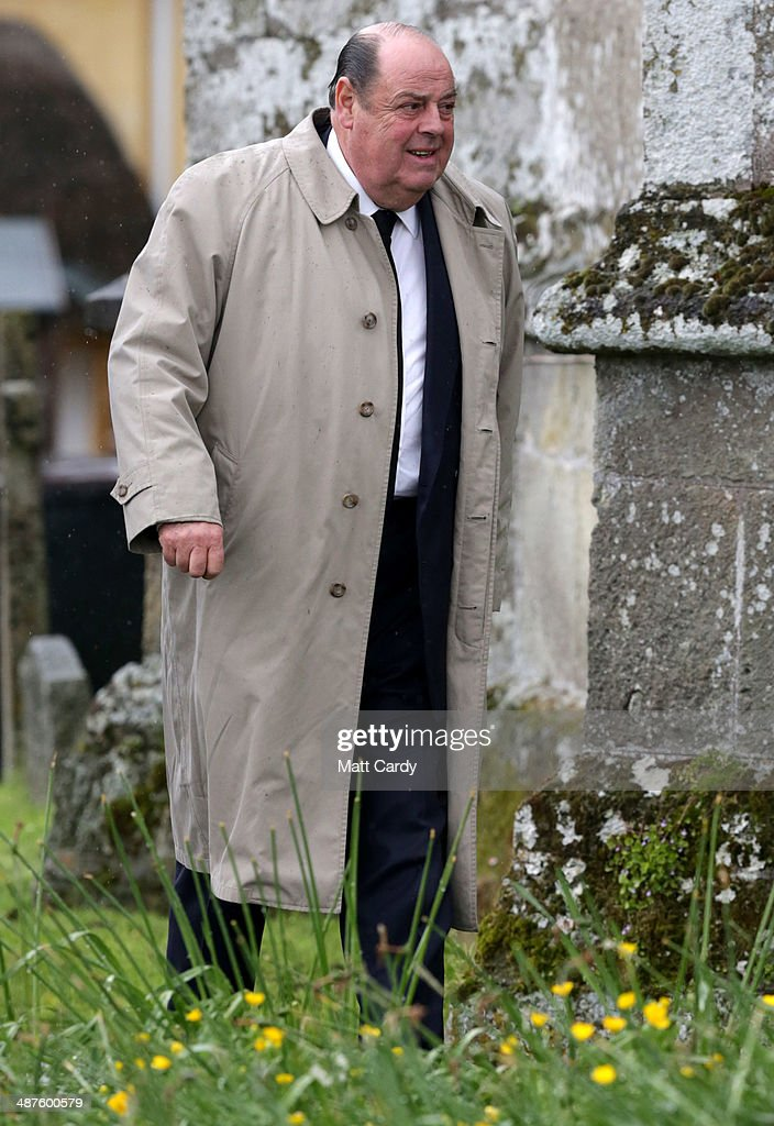 Nicholas Soames MP arrives at Holy Trinity Church for the funeral of Mark Shand in Stourpaine on May 1, 2014 near Blandford Forum in Dorset, England. Conservationist and travel writer Mr Shand, who is the brother of Camilla, Duchess of Cornwall, died unexpectedly last week after falling and hitting his head in New York.