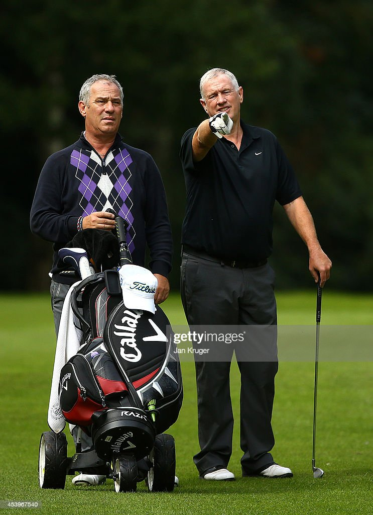Nicholas Summerfield of Prestbury GC chats with partner Paul Allen during the Golfplan Insurance PGA Pro-Captain Challenge - North (West) Regional Qualifier at Dunham Forest Golf and Country Club on August 22, 2014 in Altrincham, England.