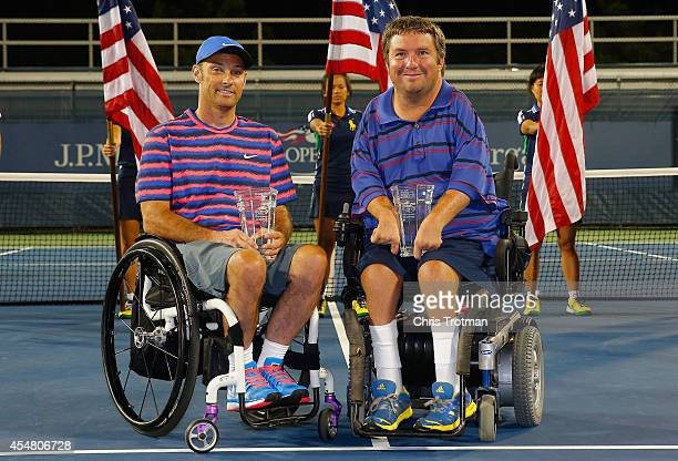 Nicholas Taylor and David Wagner celebrate with their trophies after defeating Andrew Lapthorne of Great Britain and Lucas Sithole of South Africa in...