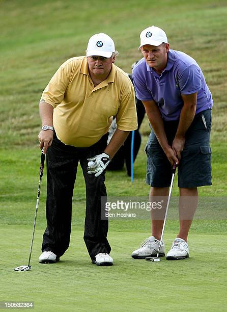 Nicholas Terry and Paul Smith of Park Wood Golf Club line up a putt during the Regional Final of the Virgin Atlantic PGA National ProAm Championship...