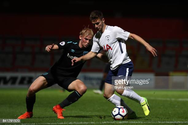 Nicholas Tsaroulla of Tottenham Hotspur holds off a challenge from Alex Pike of West Ham United during the Premier League International Cup match...