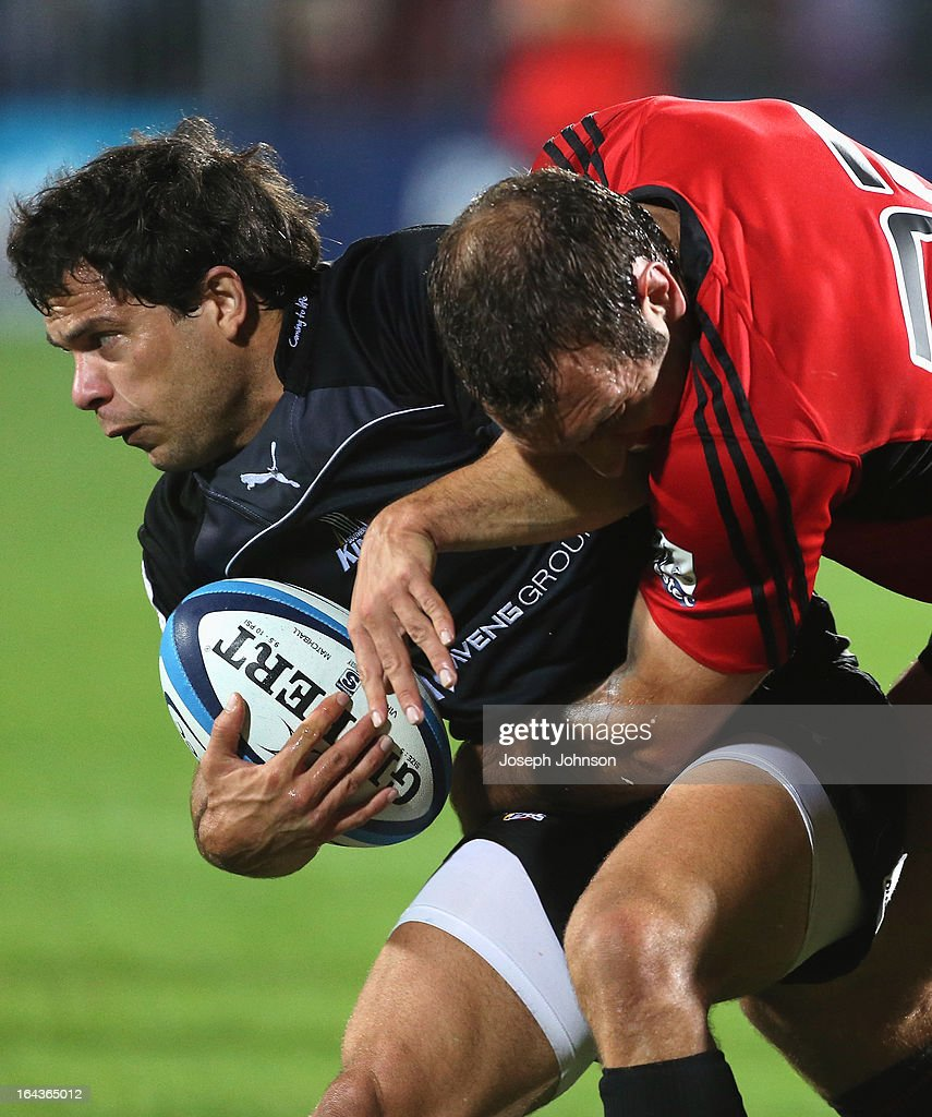 Nicholas Vergallo of the Kings in the tackle of Adam Whitelock of the Crusaders during the round six Super Rugby match between the Crusaders and the Kings at AMI Stadium on March 23, 2013 in Christchurch, New Zealand.