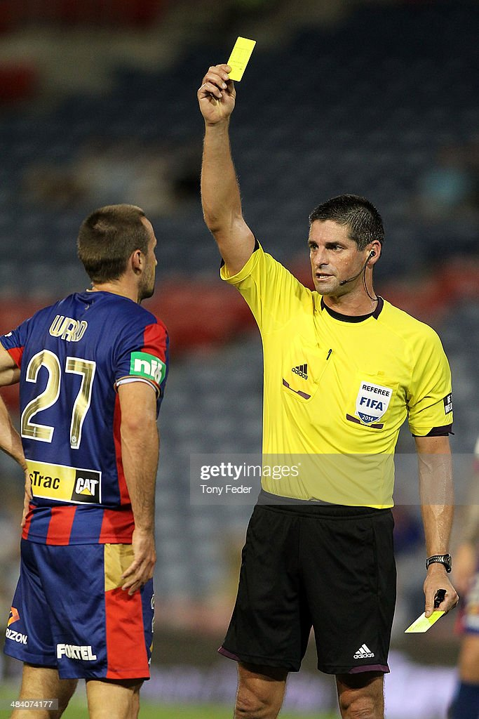 Nicholas Ward of the Jets is shown a yellow card by the referee during the round 27 A-League match between the Newcastle Jets and Adelaide United at Hunter Stadium on April 11, 2014 in Newcastle, Australia.