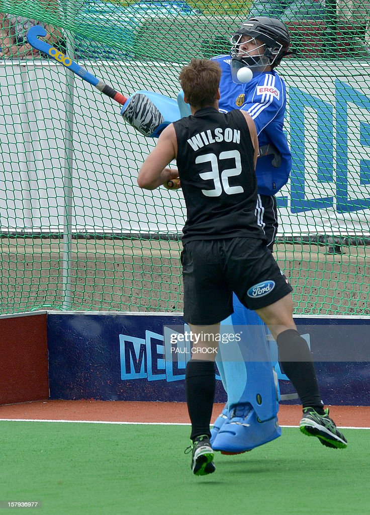 Nicholas Wilson of New Zealand (front) and keeper Nicolas Jacobi of Germany fight for the ball during their match at the men's Hockey Champions Trophy tournament in Melbourne on December 8, 2012. IMAGE STRICTLY RESTRICTED TO EDITORIAL USE - STRICTLY NO COMMERCIAL USE AFP PHOTO / Paul CROCK