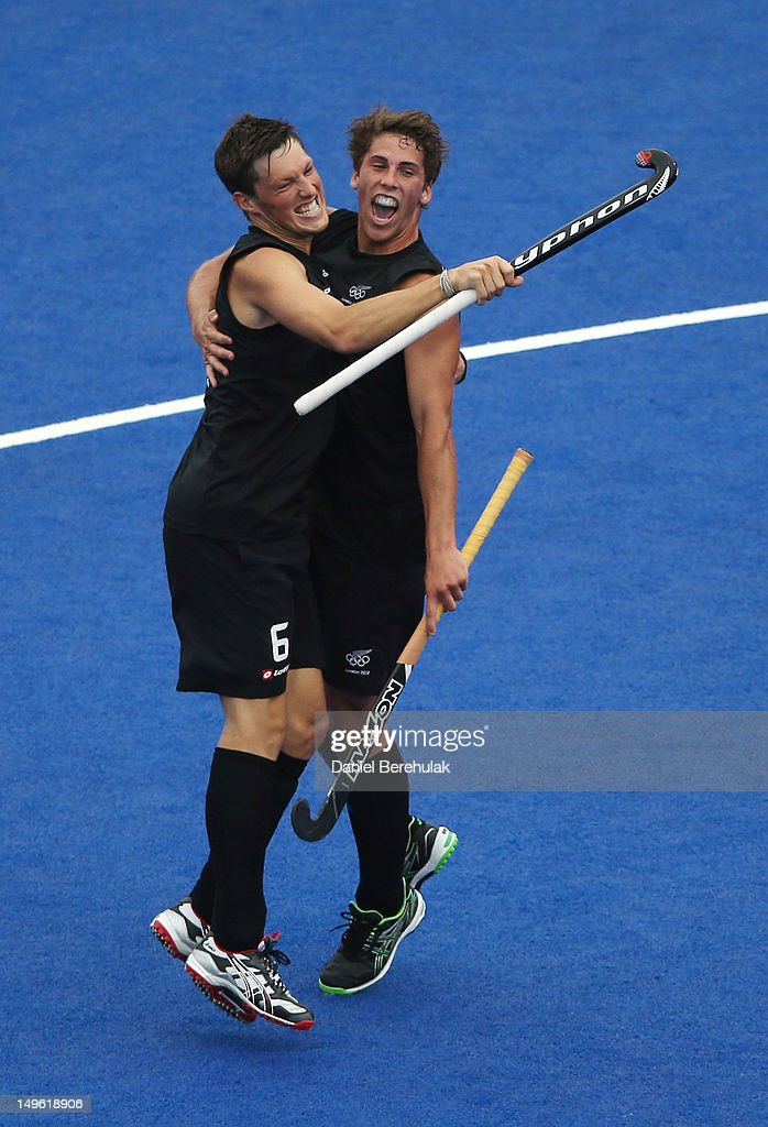 Nicholas Wilson of New Zealand celebrates his goal against India with team mate Simon Child on Day 5 of the London 2012 Olympic Games at Riverbank Arena on August 1, 2012 in London, England.