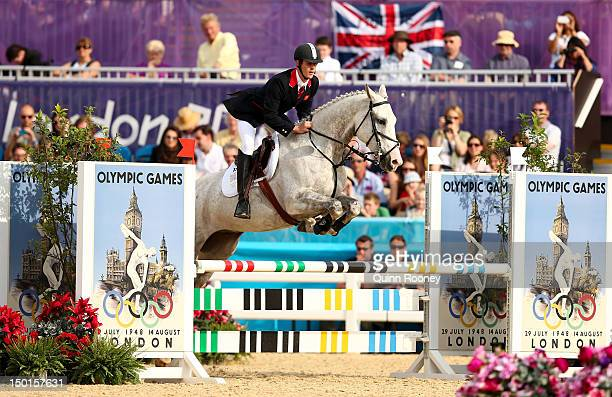 Nicholas Woodbridge of Great Britain riding Umberto de Fauquez competes in the Riding Show Jumping during the Men's Modern Pentathlon on Day 15 of...