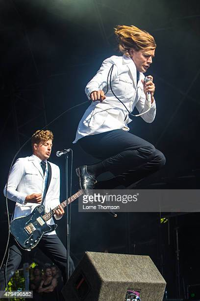 Nicholaus Arson and Howlin' Pelle Almqvist of The Hives perform at Clapham Common on July 4 2015 in London England