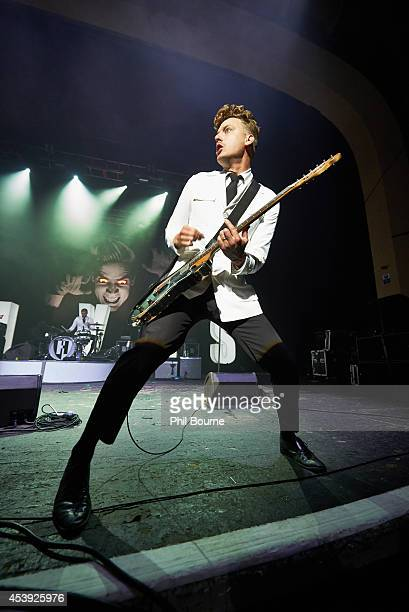 Nicholaus Arson of The Hives performs on stage at Brixton Academy on August 21 2014 in London United Kingdom