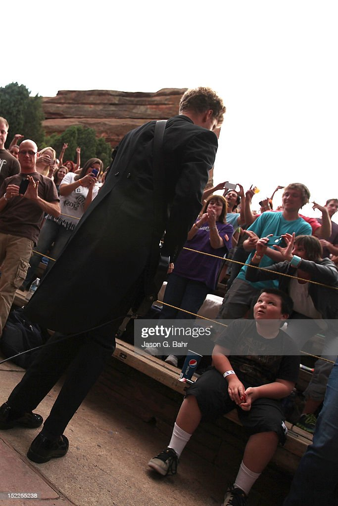 Nicholaus Arson (Niklas Almqvist) of the Hives takes to the crowd during a performance at Red Rocks Amphitheatre on September 16, 2012 in Morrison, Colorado.