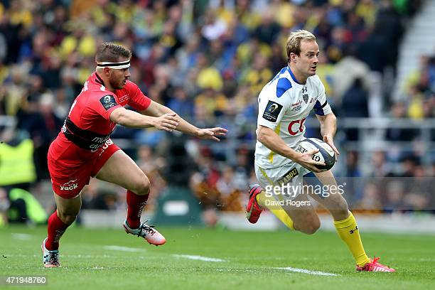 Nick Abendanon of Clermont goes past Drew Mitchell of Toulon during the European Rugby Champions Cup Final match between ASM Clermont Auvergne and RC...