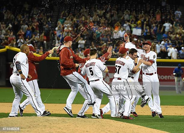 Nick Ahmed of the Arizona Diamondbacks and teammates celebrate a walkoff single in the thirteenth inning against the Chicago Cubs at Chase Field on...