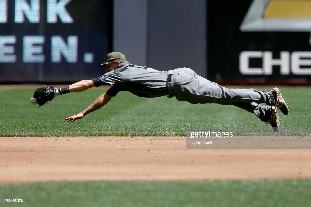Nick Ahmed #13 of the Arizona Diamondbacks dives after a ground ball in the second inning against the Milwaukee Brewers at Miller Park on May 28, 2017 in Milwaukee, Wisconsin.