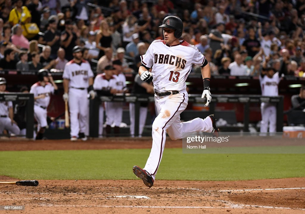 Nick Ahmed #13 of the Arizona Diamondbacks scores a run on a single by AJ Pollock against the Detroit Tigers during the sixth inning at Chase Field on May 10, 2017 in Phoenix, Arizona.