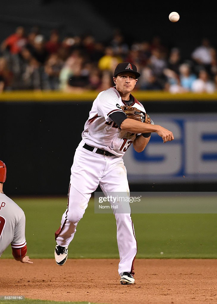Nick Ahmed #13 of the Arizona Diamondbacks throws the ball to first base against the Philadelphia Phillies at Chase Field on June 27, 2016 in Phoenix, Arizona.