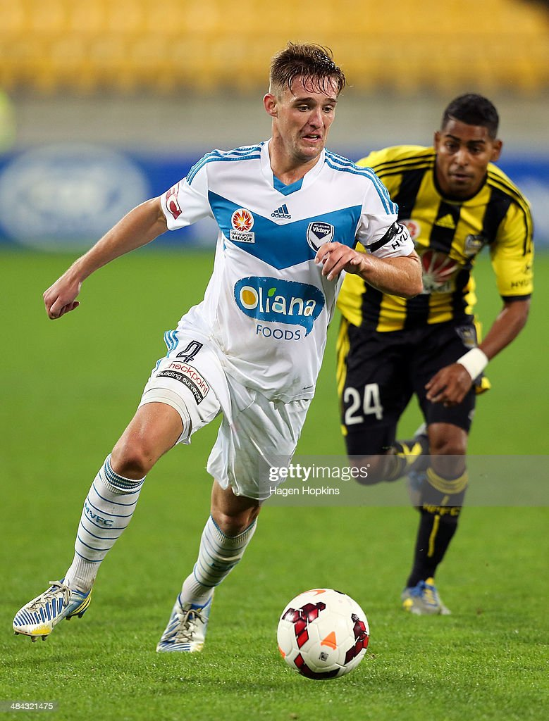 Nick Ansell of the Victory beats the defence of Roy Krishna of the Phoenix during the round 27 A-League match between Wellington Phoenix and Melbourne Victory at Westpac Stadium on April 12, 2014 in Wellington, New Zealand.