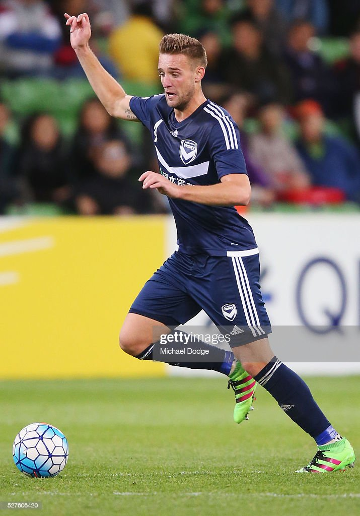 Nick Ansell of the Victory runs with the ball during the AFC Champions League match between Melbourne Victory and Gamba Osaka at AAMI Park on May 3, 2016 in Melbourne, Australia.