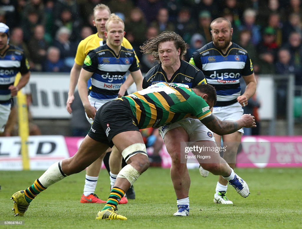 Nick Auterac of Bath is tackled by <a gi-track='captionPersonalityLinkClicked' href=/galleries/search?phrase=Courtney+Lawes&family=editorial&specificpeople=5385543 ng-click='$event.stopPropagation()'>Courtney Lawes</a> during the Aviva Premiership match between Northampton Saints and Bath at Franklin's Gardens on April 30, 2016 in Northampton, England.