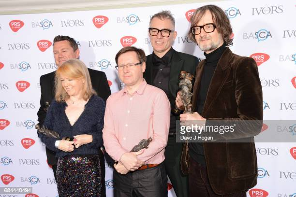 Nick Banks Candida Doyle Mark Webber Steve Mackey and Jarvis Cocker of the band Pulp pose with the award for Outstanding Song Collection in the...