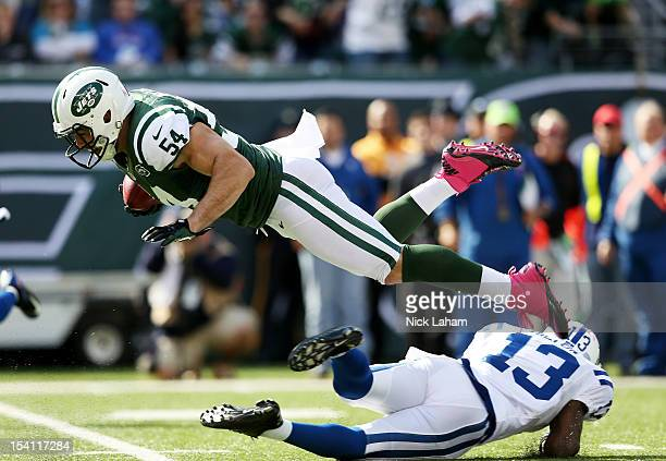 Nick Bellore of the New York Jets is tackled by TY Hilton of the Indianapolis Colts at MetLife Stadium on October 14 2012 in East Rutherford New...
