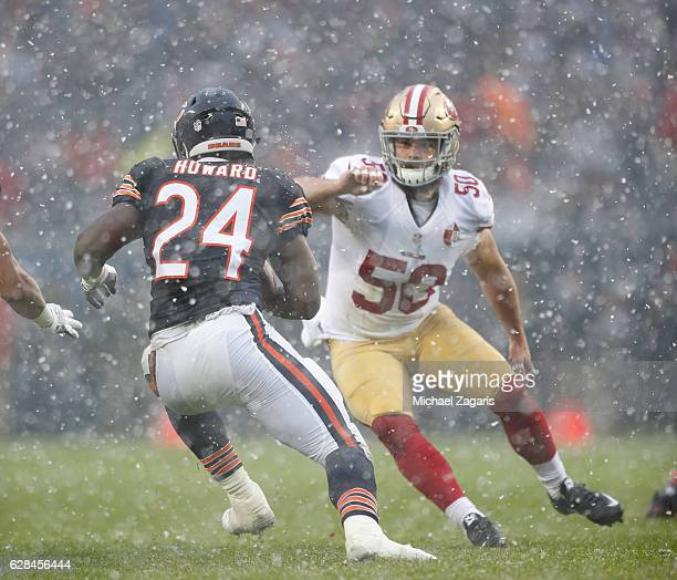 Nick Bellore of the San Francisco 49ers eyes a rushing Jordan Howard of the Chicago Bears during the game at Soldier Field on December 4 2016 in...