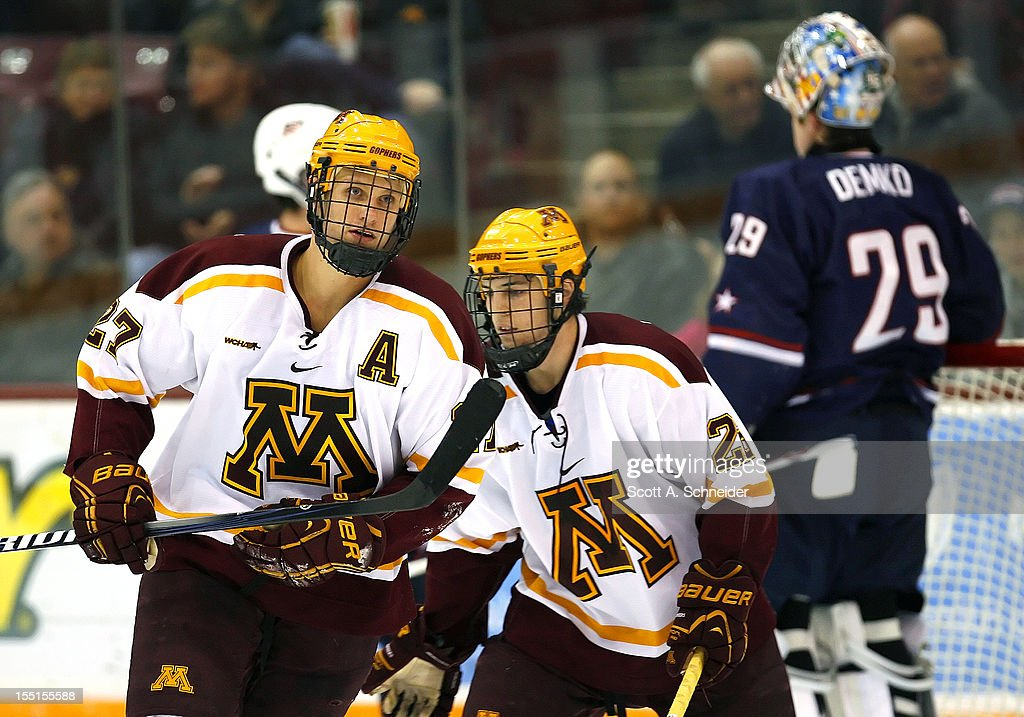 Nick Bjugstad #27 and Christian Isackson #26 of the University of Minnesota head to the bench after Bjugstad scored Minnesota's second goal against the United States U-18 team October 26, 2012 at Mariucci Arena in Minneapolis, Minnesota.