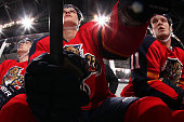Nick Bjugstad of the Florida Panthers and teammate Jonathan Huberdeau sit on the bench between shifts against the Buffalo Sabres at the BBT Center on...