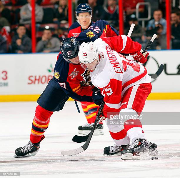Nick Bjugstad of the Florida Panthers faces off against Cory Emmerton of the Detroit Red Wings at the BBT Center on December 10 2013 in Sunrise...