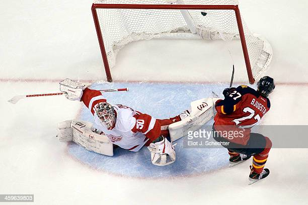 Nick Bjugstad of the Florida Panthers scores a goal against Goaltender Jonas Gustavsson of the Detroit Red Wings at the BBT Center on December 28...