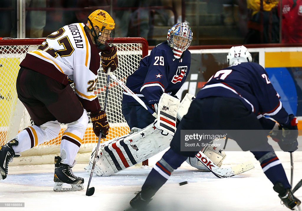 Nick Bjugstad #27 of the University of Minnesota goes for a loose puck as Thatcher Demko #29 and Gage Ausmus #27 of United States U-18 try to stop him October 26, 2012 at Mariucci Arena in Minneapolis, Minnesota.